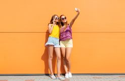Teen girls taking selfie by smartphone in summer Royalty Free Stock Images