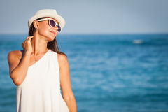 Fashion Lifestyle, Beautiful girl on the beach at the day time Royalty Free Stock Images
