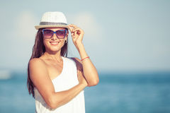 Fashion Lifestyle, Beautiful girl on the beach at Royalty Free Stock Images