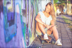 Fashion lifestyle, Beautiful young blonde woman with skateboard Royalty Free Stock Photography