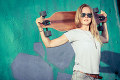 Fashion lifestyle, Beautiful young blonde woman with skateboard Stock Images