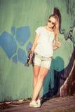 Fashion lifestyle, Beautiful young blonde woman with skateboard Stock Photo