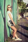 Fashion lifestyle, Beautiful young blonde woman with skateboard Royalty Free Stock Photo