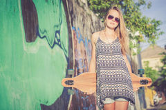 Fashion lifestyle, Beautiful young blonde woman with skateboard Stock Photo