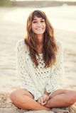 Fashion lifestyle, beautiful young woman on the beach at sunset Royalty Free Stock Images