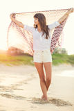 Fashion lifestyle, beautiful young woman on the beach at sunset Stock Photography