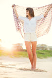 Fashion lifestyle, beautiful young woman on the beach at sunset Royalty Free Stock Photography