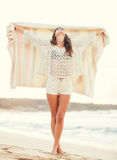 Fashion lifestyle, beautiful young woman on the beach at sunset Royalty Free Stock Photos
