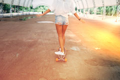 Fashion lifestyle, beautiful young woman with longboard Stock Photography