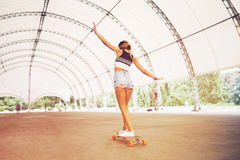Fashion lifestyle, beautiful young woman with longboard Stock Images