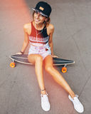 Fashion lifestyle, beautiful young woman with longboard Royalty Free Stock Photos