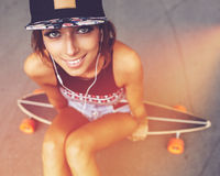 Fashion lifestyle, beautiful young woman with longboard Stock Image