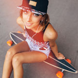 Fashion lifestyle, beautiful young woman with longboard Stock Image