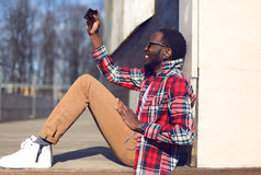 Fashion lifestyle photo happy young african man makes selfie Stock Photography