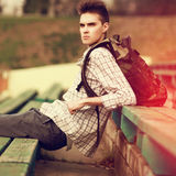 Fashion lifestyle portrait of handsome hipster man with backpack Royalty Free Stock Photo