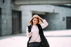 Fashion lifestyle portrait of young happy pretty woman laughing and having fun on the street at nice sunny summer day Stock Image