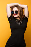Fashion lifestyle portrait of young happy pretty woman laughing in  Large Round Sunglasses Royalty Free Stock Image