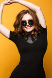 Fashion lifestyle portrait of young happy pretty woman laughing in  Large Round Sunglasses Royalty Free Stock Photo