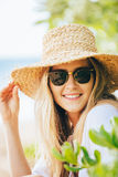 Fashion lifesytle, Portrait of beautiful blond girl on the beach Royalty Free Stock Image