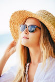 Fashion lifesytle, Portrait of beautiful blond girl on the beach Royalty Free Stock Photos