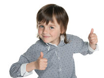 Fashion little boy holds his thumbs up. A fashion little boy holds his thumbs up on the white background royalty free stock photo
