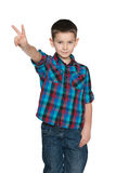 Fashion little boy shows victory sign Stock Photos