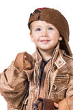 Fashion little boy wearing a leather jacket. Portrait of a little boy dressed in an adult leather jacket and a baseball cap isolated on white background Royalty Free Stock Photos