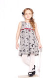 Fashion little girl. Posing in gray dresses Royalty Free Stock Photo