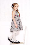 Fashion little girl. Posing in gray dresses Royalty Free Stock Photography