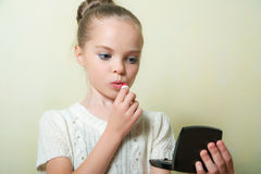 Fashion little girl applying make up. Stock Photography