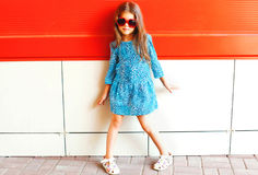 Fashion little girl child in a leopard dress with sunglasses Royalty Free Stock Photo