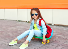 Fashion little girl child with skateboard having fun Stock Photo