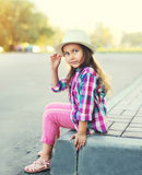 Fashion little girl child wearing a checkered pink shirt and hat Royalty Free Stock Image
