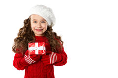 Fashion little girl with Christmas gift, isolated on white background Royalty Free Stock Image
