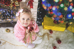 Fashion little girl decorating Christmas tree Royalty Free Stock Images
