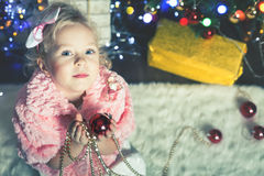 Fashion little girl decorating Christmas tree Royalty Free Stock Photography