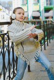 Fashion little girl with headphone listening to music outdoor Royalty Free Stock Images