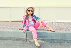 Fashion little girl model wearing a pink shirt, hat and sunglasses Royalty Free Stock Photos