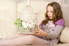Fashion little girl sitting on sofa Royalty Free Stock Image