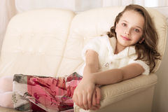 Fashion little girl on sofa Royalty Free Stock Image