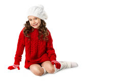 Fashion little girl in winter knitted clothes on isolated white background. New Year, christmas, holidays concept. Fashion little girl in winter knitted clothes Royalty Free Stock Photography
