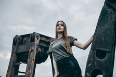 Fashion lonely girl in motion posing on city of urban background stock images