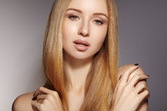 Fashion long hair. Beautiful blond girl. Healthy straight shiny hair style. Beauty woman model. Smooth hairstyle Royalty Free Stock Photos
