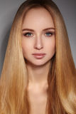 Fashion long hair. Beautiful blond girl. Healthy straight shiny hair style. Beauty woman model. Smooth hairstyle Stock Photography