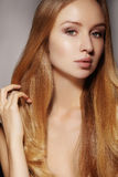 Fashion long hair. Beautiful blond girl,. Healthy straight shiny hair style. Beauty woman model. Smooth hairstyle Royalty Free Stock Photos
