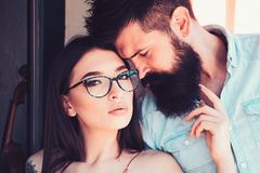Fashion is about a look. Sensual woman and bearded man in love relations. Fashion models. Girlfriend and boyfriend in stock image