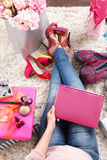 Fashion lover woman relaxing at home Royalty Free Stock Photography