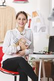 Fashion magazine editor in her office. Young fashion woman working royalty free stock images