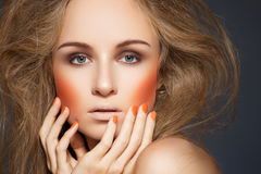 Fashion make-up, blusher, manicure, big hairstyle royalty free stock photography