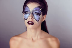 Fashion Make up. Butterfly makeup on face beautiful woman. Art P Stock Images